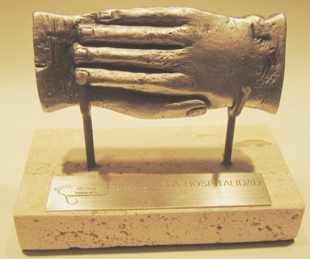 Tessera Hospitalis, en forma de manos entrelazadas, fechada en el siglo I a.C.